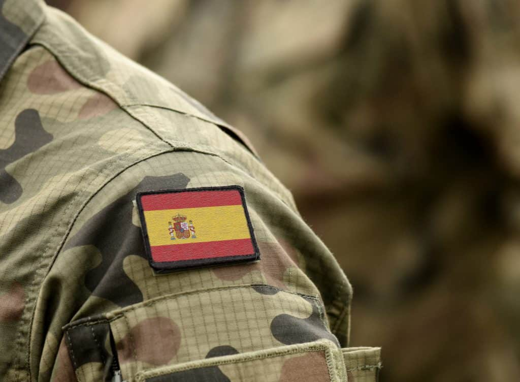 Flag of Spain on military uniform. Army, troops, soldier (collage).